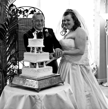 cutting the cake at Corn Mill Lodge Hotel, wedding photographers in Bramley