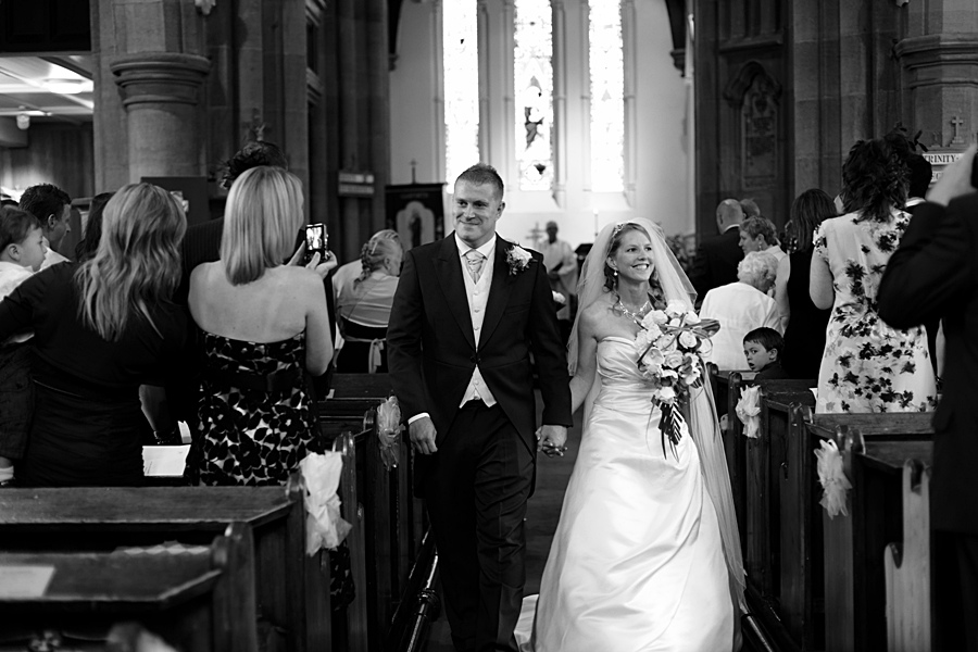 St Mary's Church, Garforth, bride and groom, aisle, church wedding photographers in Leeds