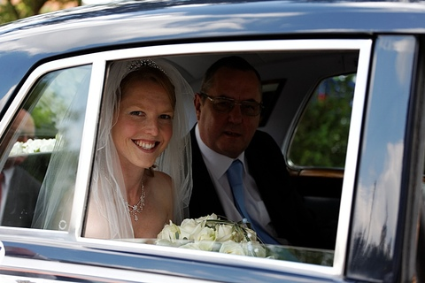Garforth wedding photographers, bride in wedding car, flowers, wedding photography in Leeds